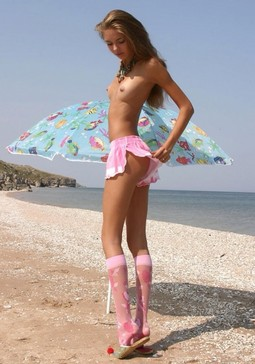 Petite chick at ocean in pink.