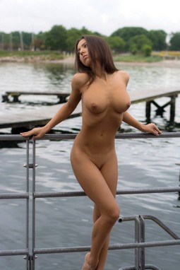 Hot nude young brunette has so wet hot young pussy and real great breasts